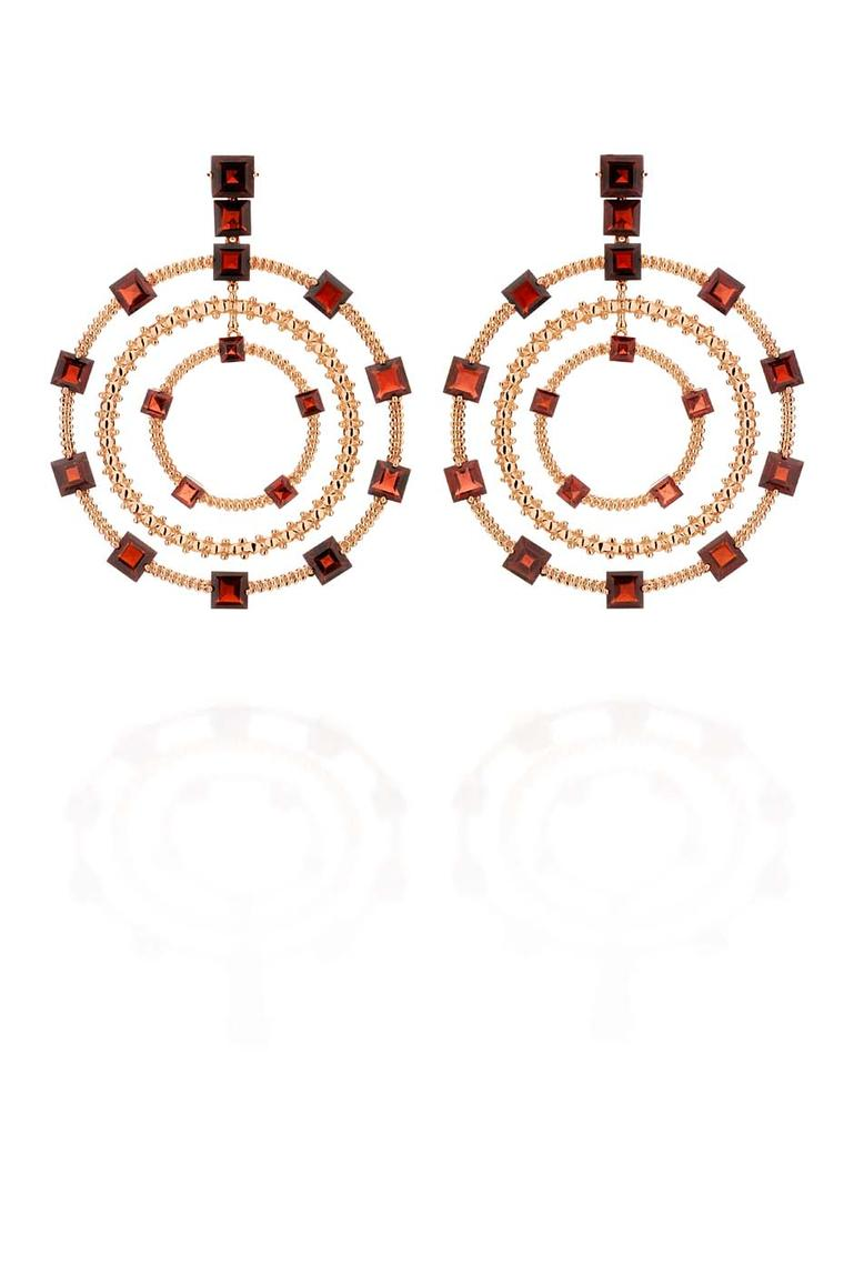 Carla Amorim hoop earrings in rose gold with square-cut red garnets, from the Sao Paulo collection.