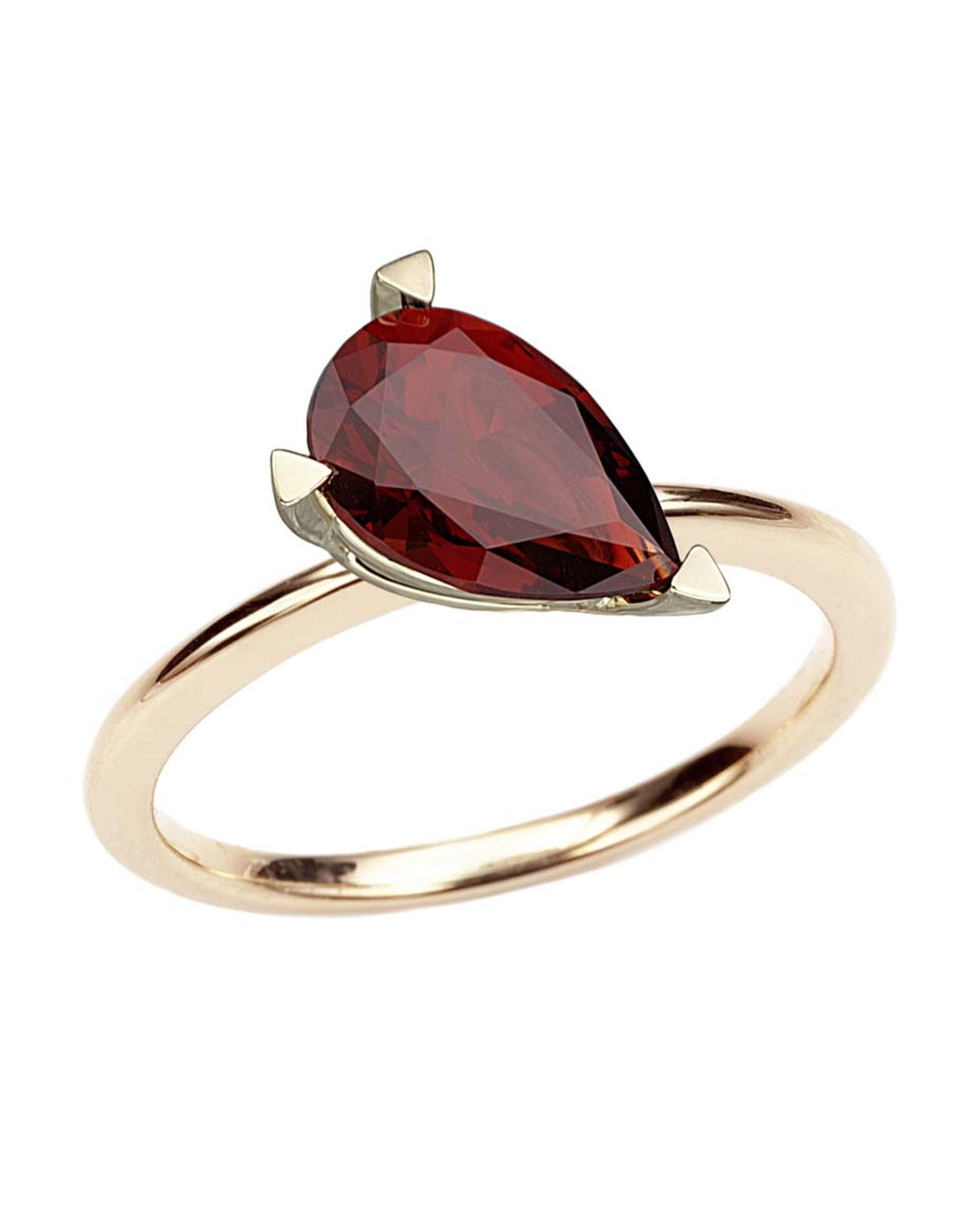 Octium ring in yellow gold with a large pear-cut garnet.