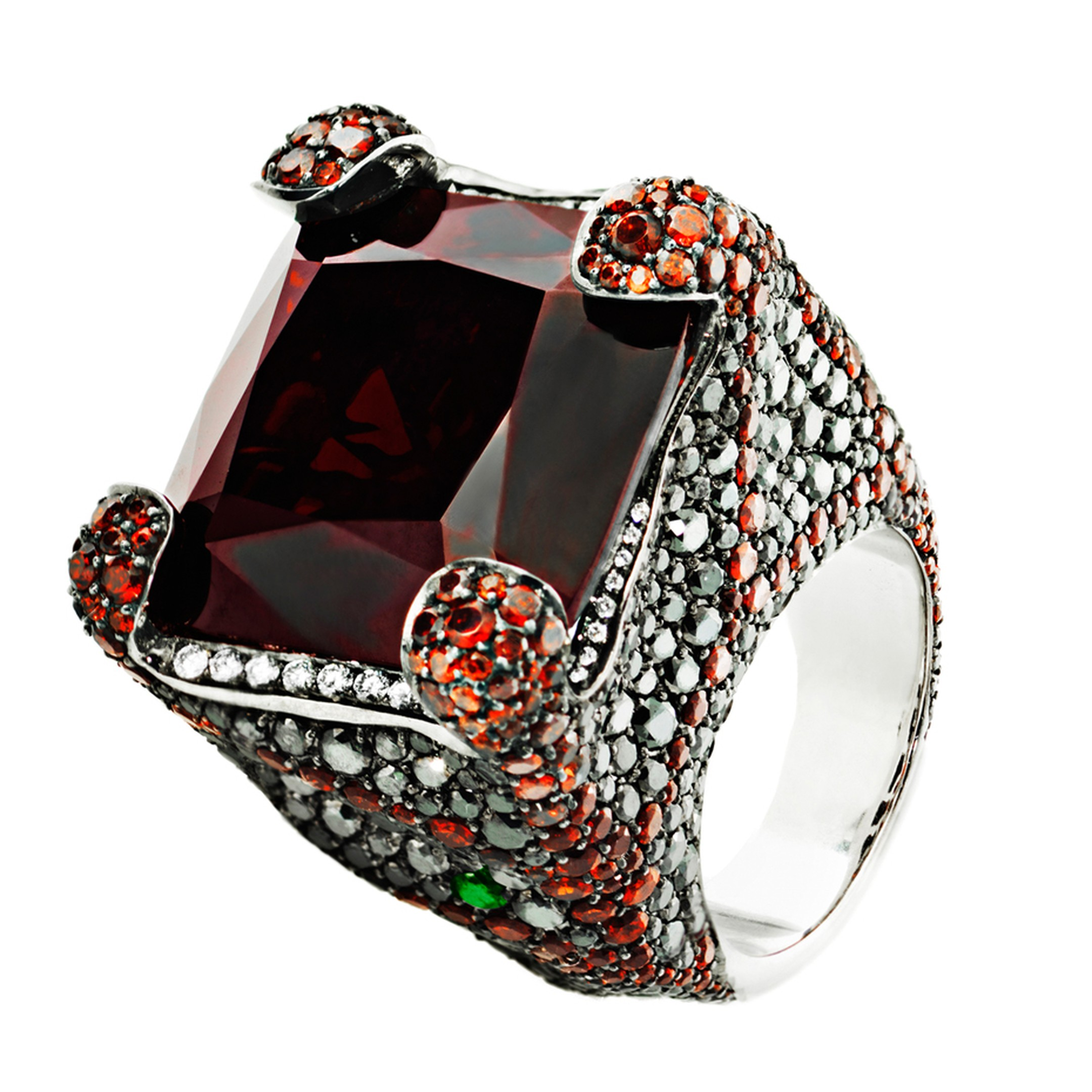 Crow's Nest ring set with white and black diamonds, a central red garnet and a pear-shaped tsavorite, from the Deluxe Russian Grooves collection.