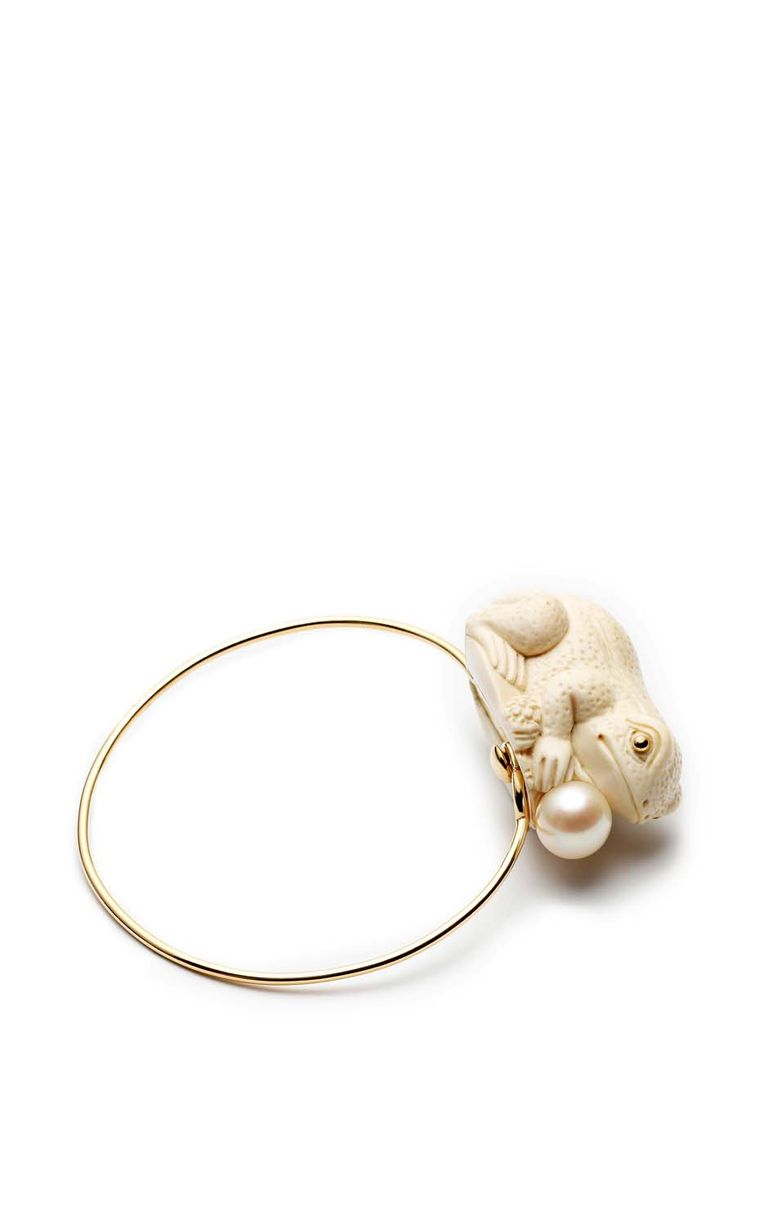 Bibi Van der Velden bracelet in yellow gold featuring a frog perched on your wrist, hand carved from fossilised woolly mammoth tusk.