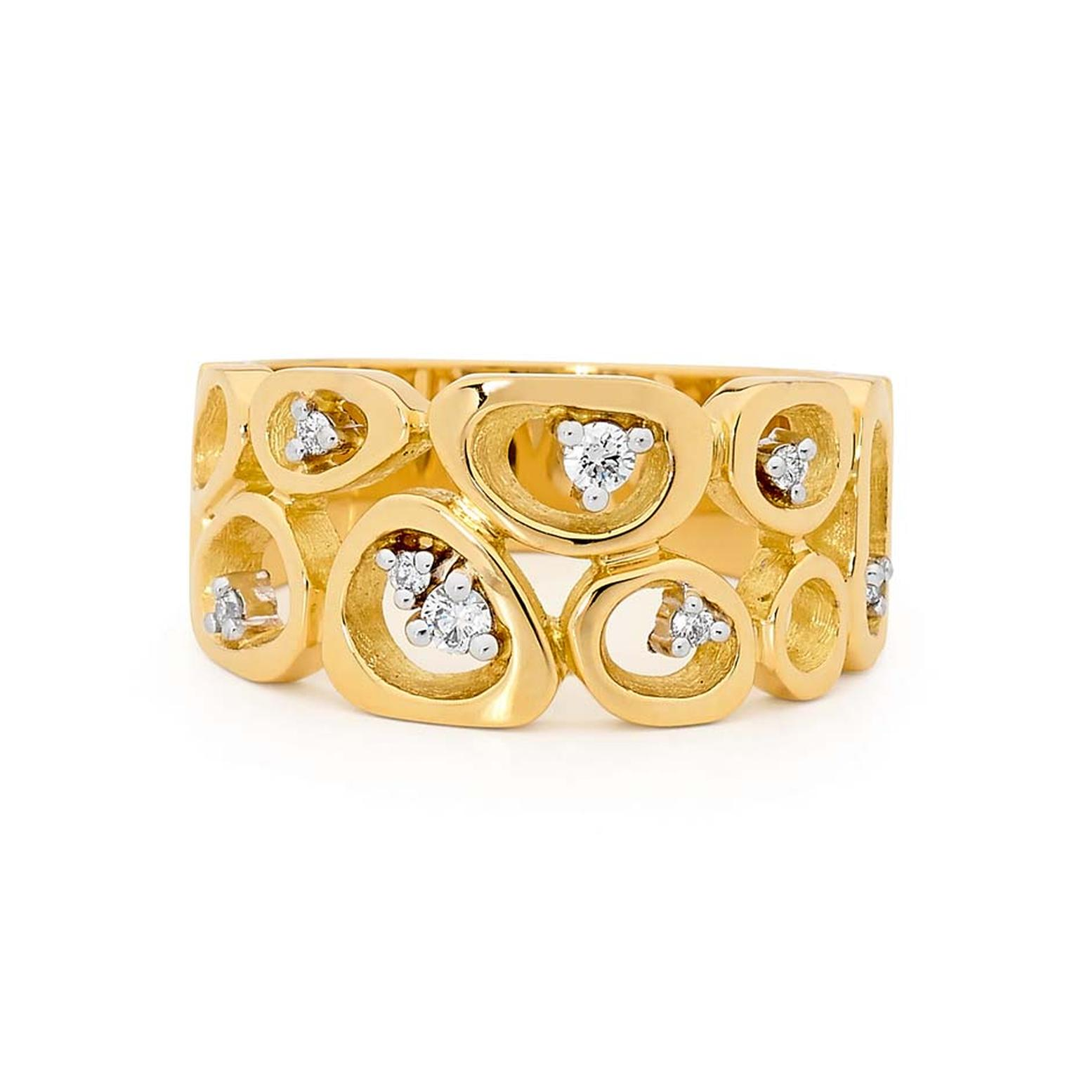 Linneys ring in yellow and white gold with diamonds.