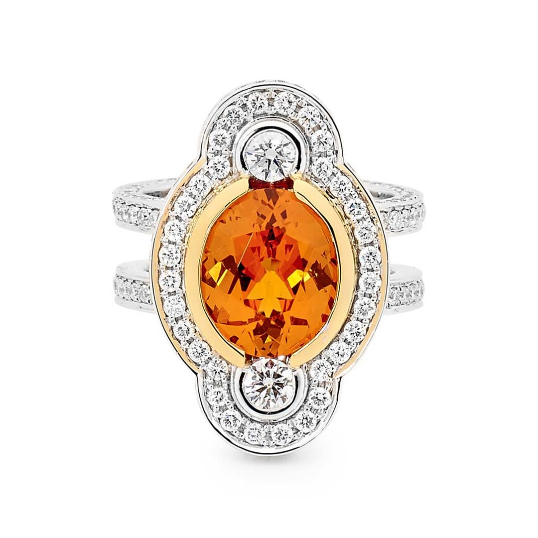 Linneys ring in white and yellow gold with a central spessartite and diamonds.