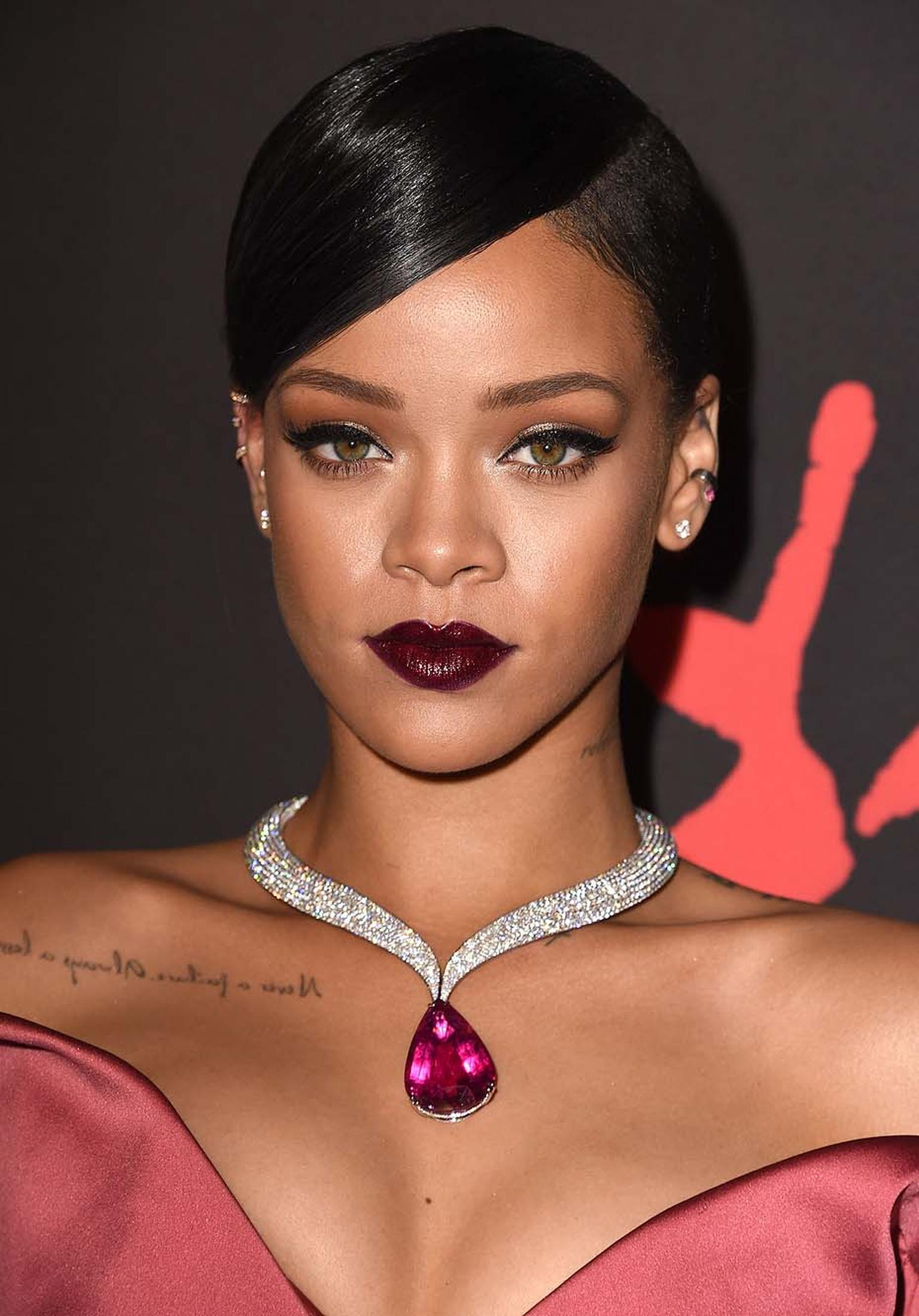 Perching just above Rihanna's racy décolleté, the curvaceous singer flaunted a bright pink rubellite and diamond Chopard necklace.