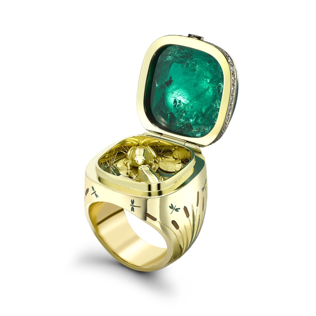 Theo Fennell's Kissing Frogs African emerald ring opens to reveal a pair of gold frogs.