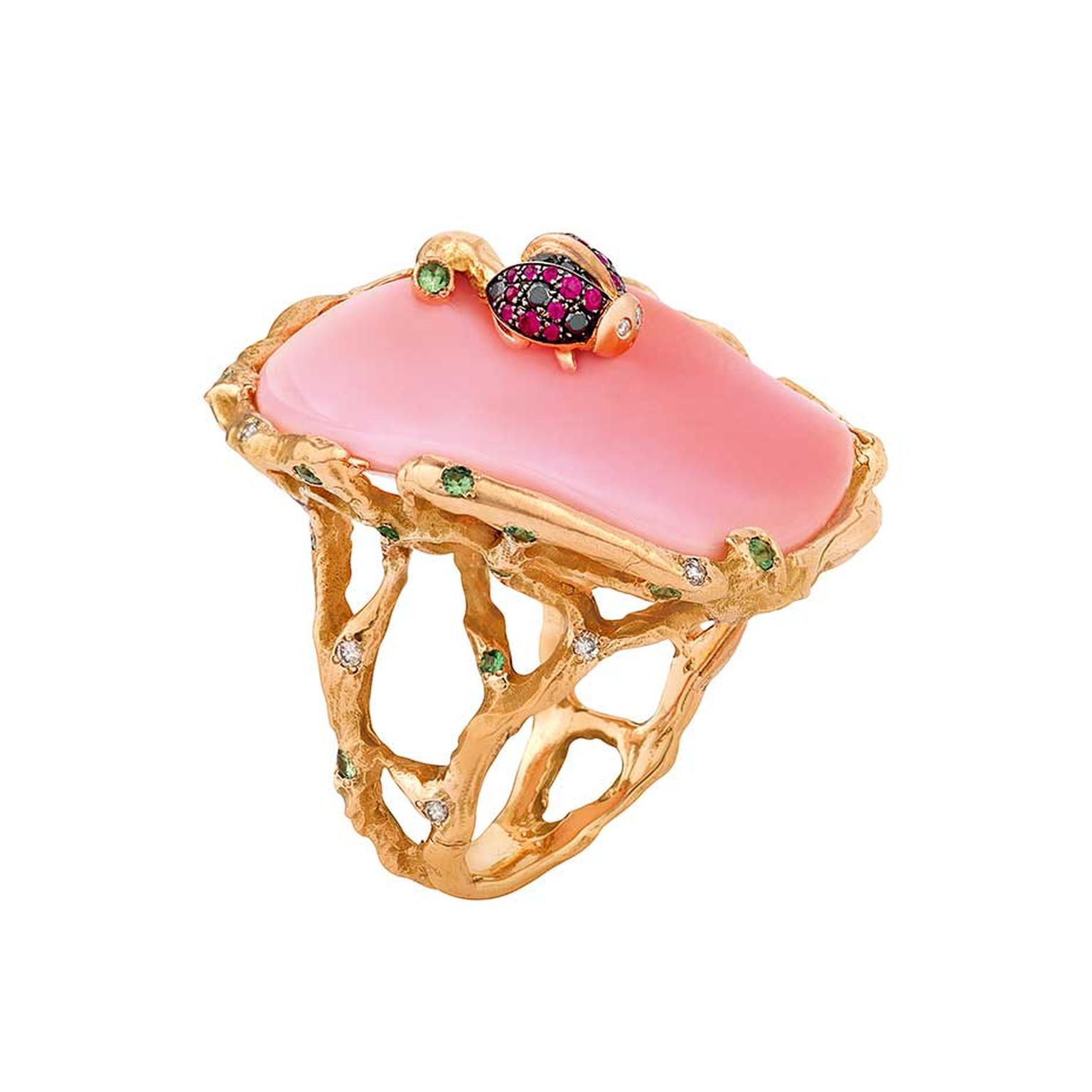 Christina Debs ring set with a conch shell and white diamonds, topped with a gem-set pink gold ladybird, from the Mother Nature collection.
