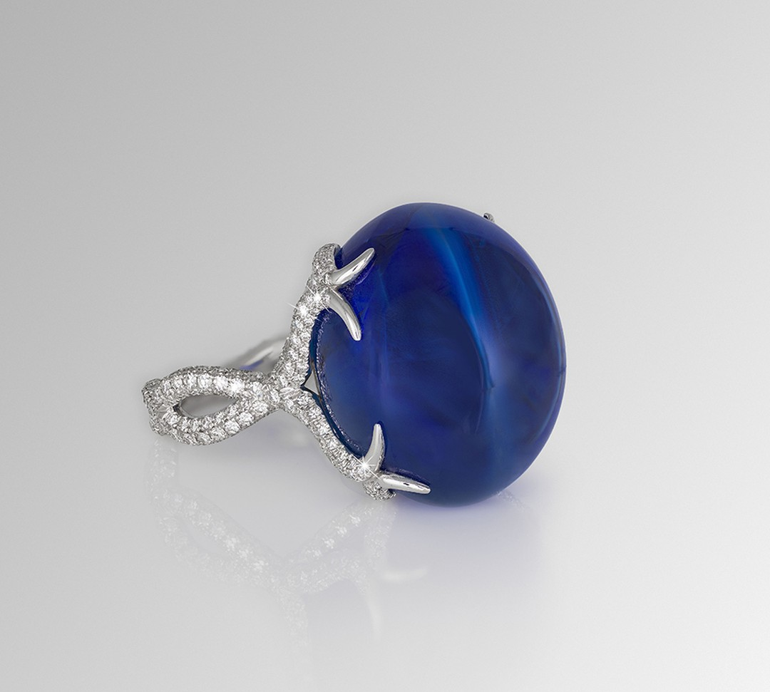 One-of-a-kind David Morris ring, set with a 64.55ct sapphire double cabochon and diamonds.