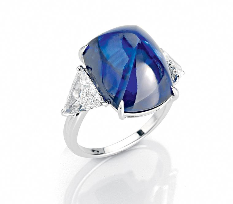 One-of-a-kind Faraone ring in platinum, set with a sugarloaf cabochon sapphire.