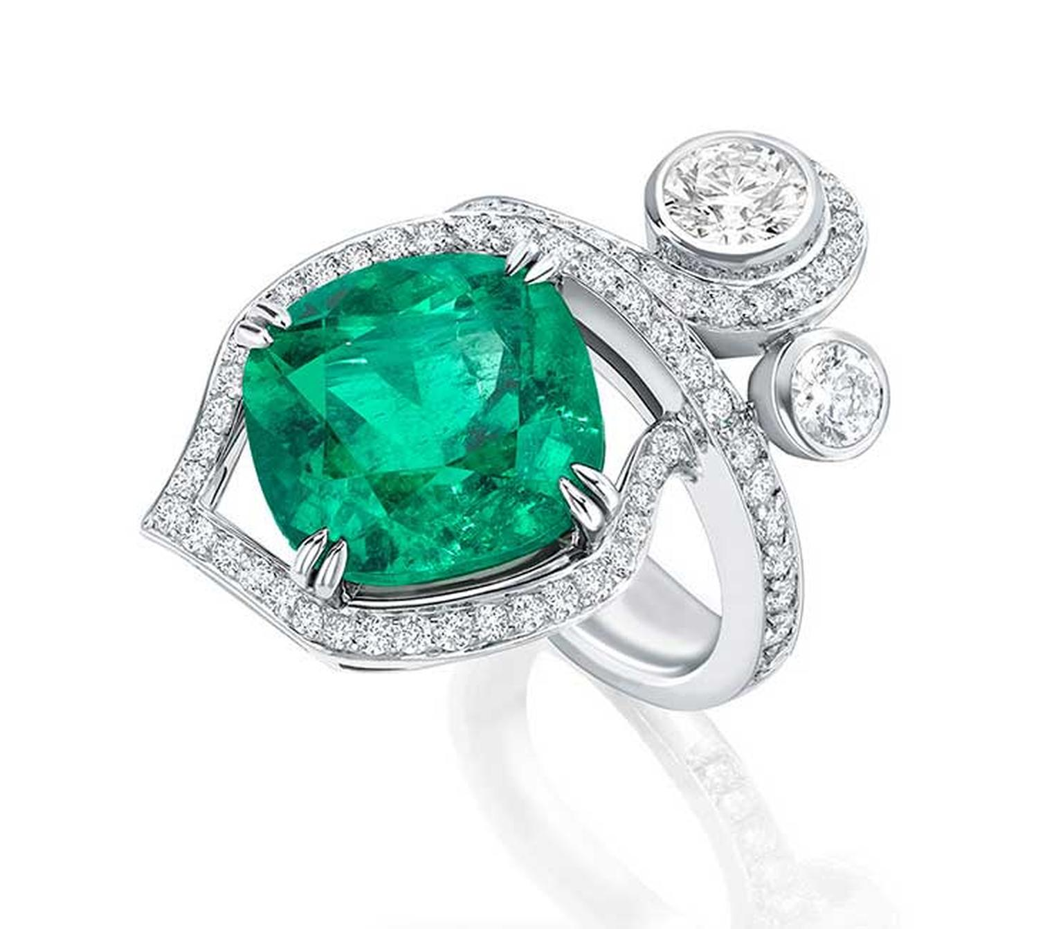 Boodles Greenfire emerald ring, set with a single emerald surrounded by pavé diamonds and two brilliant-cut diamonds designed to look like entwined forest foliage.