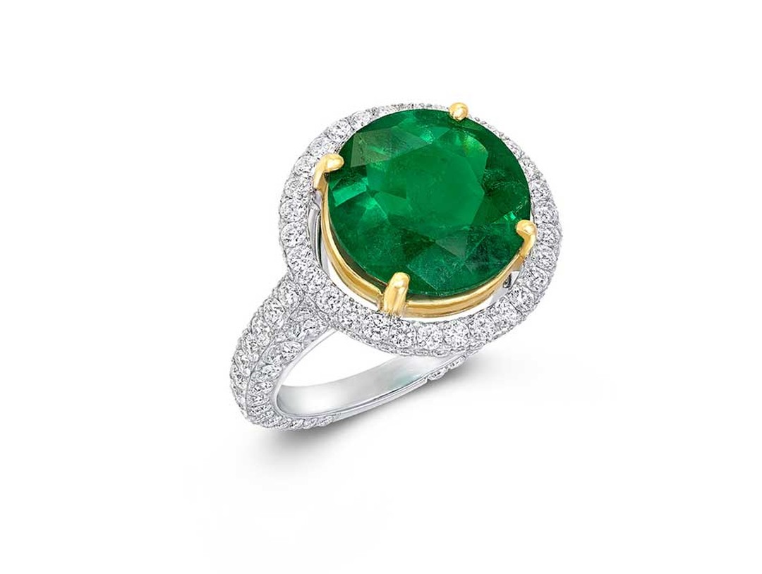 Graff emerald ring in white and yellow gold, set with a 3.78ct round-cut emerald and diamonds.