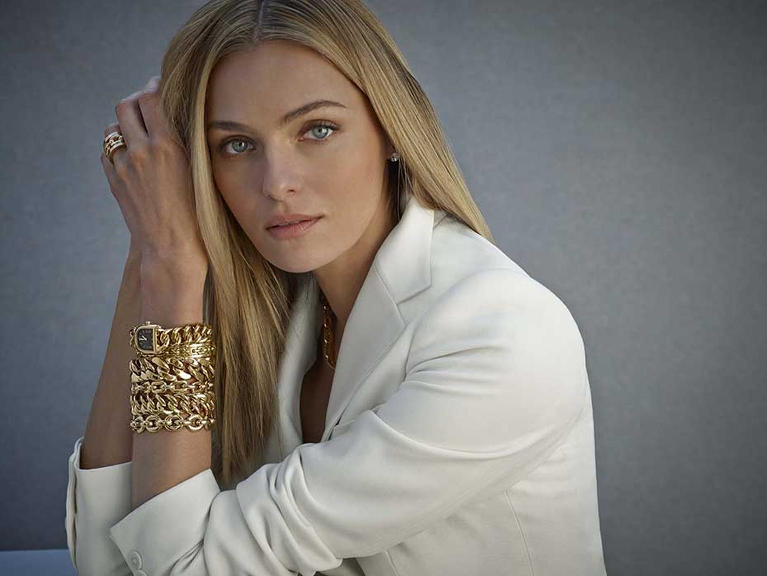 Model wearing Ralph Lauren Chunky Chain bracelets and rings