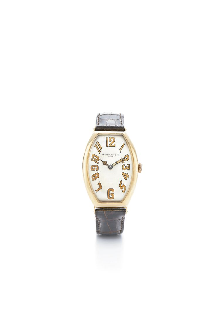 Art Deco Tonneau gold watch by Patek Philippe, circa 1923, restored by Fred Leighton.