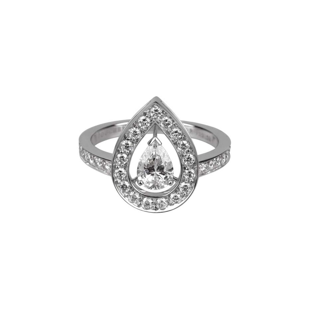 Boucheron Ava white gold engagement ring features a central pear-cut diamond that appears to float in mid-air amidst thirty-five round diamonds.