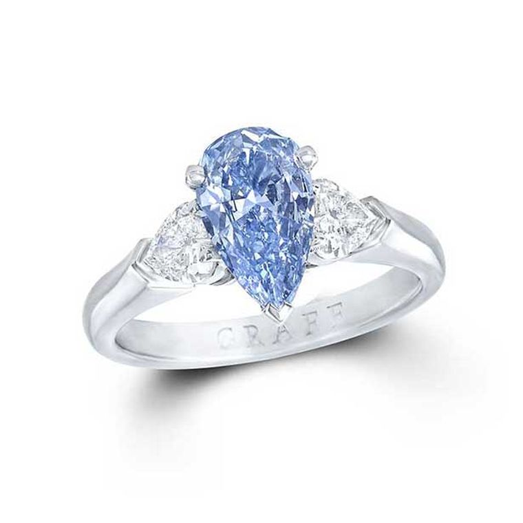 Graff 1.04ct Internally Flawless Fancy Deep blue diamond engagement ring flanked by two pear-shaped white diamonds.