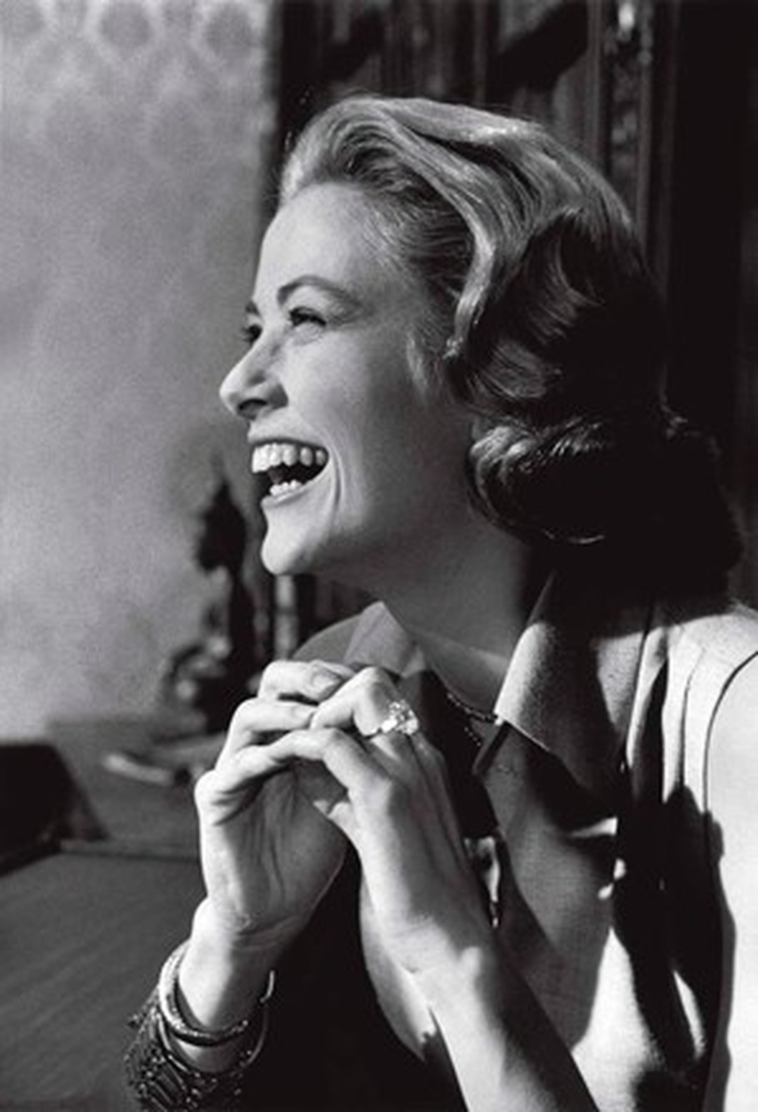 Princess Grace wearing her 10.47ct Cartier diamond engagement ring, given to her by Prince Rainier III.