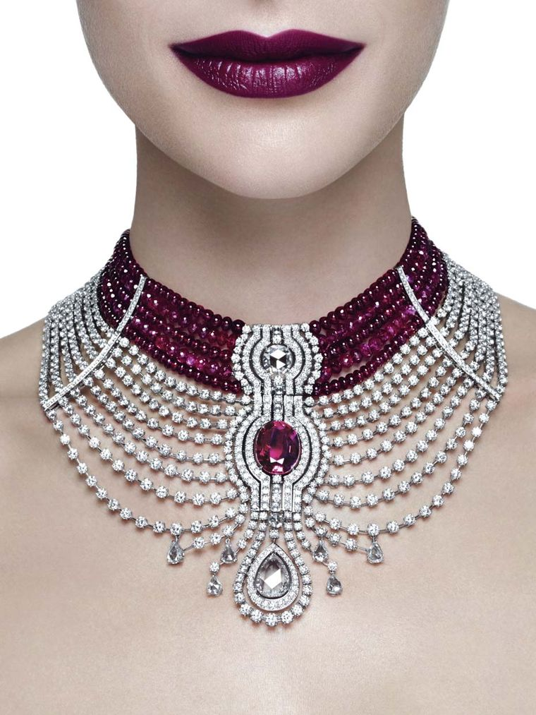 The star of Cartier's Reine Makéda ruby necklace, part of the Royal collection created for the Biennale des Antiquaires 2014, is a 15.00ct oval-shaped Mozambique ruby, with ruby beads and diamonds completing the elaborate choker-style necklace.
