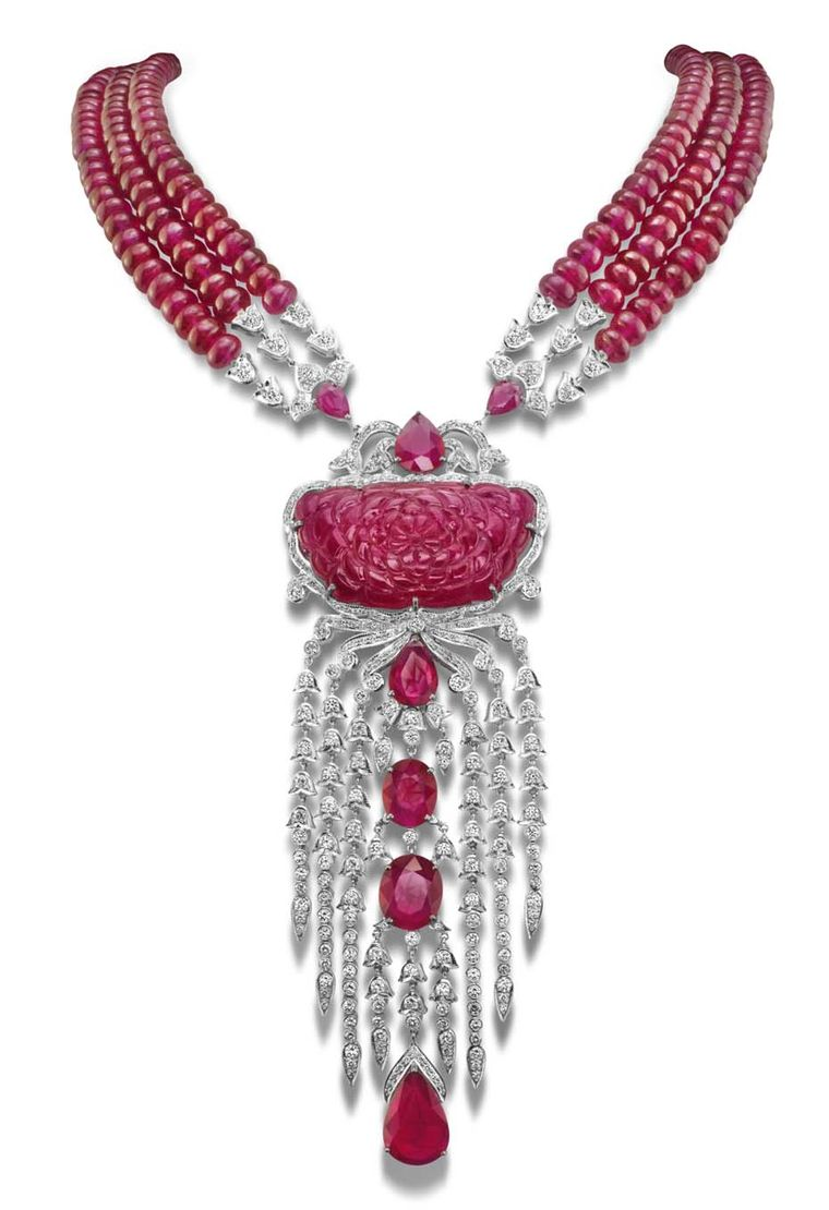 The House of Rose necklace with a carved ruby centre, strung on ruby beads and set with brilliant-cut diamonds and faceted rubies in white gold.