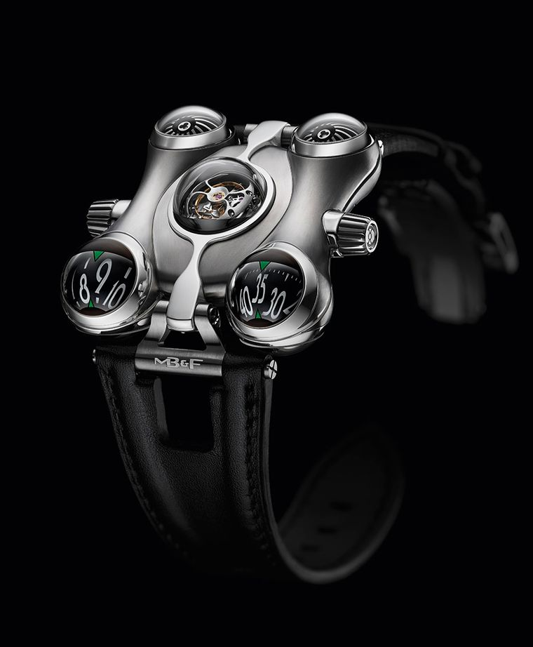 MB&F HM6 Space Pirate was inspired by a 1970s Japanese cartoon. Crafted in titanium, this lightweight ship features five bubble-domed pods on its hull: the front two for hours and minutes; the central one to show off the tourbillon; and the rear two to di