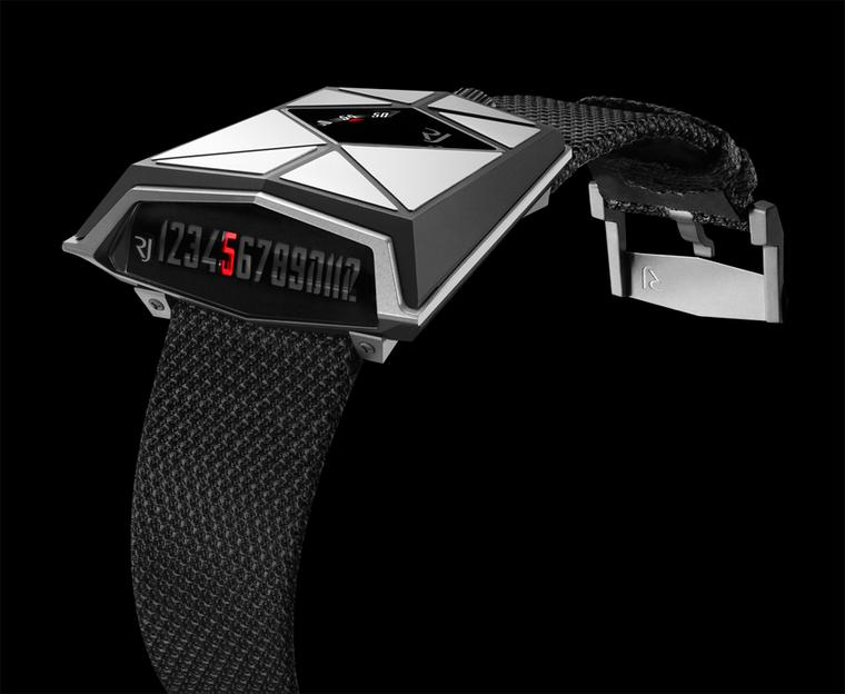 Romain Jerome Spacecraft watch has an unusual trapeze-shaped titanium case. The minutes are indicated on the surface of the spaceship while the retrograde hours are shown on a linear display