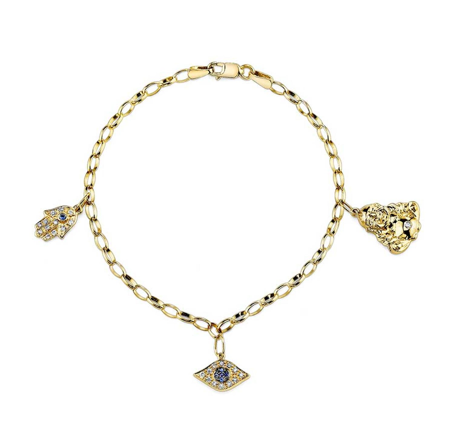 Sydney Evan Lucky Charm bracelet in gold with diamonds and sapphires.