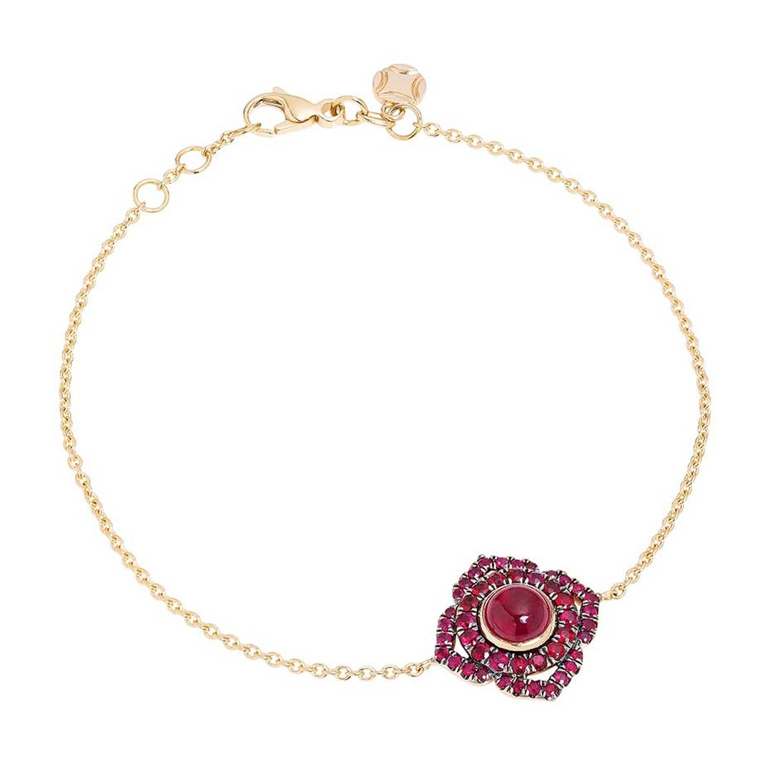 Vanessa Kandiyoti Chakra rose gold bracelet with a cabochon ruby and pavé rubies.