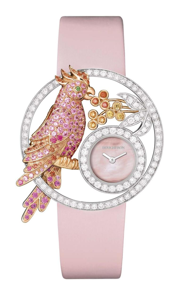 Boucheron Ajourée Nuri watch features a pretty parrot perched on a branch nibbling tropical fruit. Swathed in diamonds and orange-pink sapphires and with a pink mother-of-pearl dial, the parrot sparkles with life.