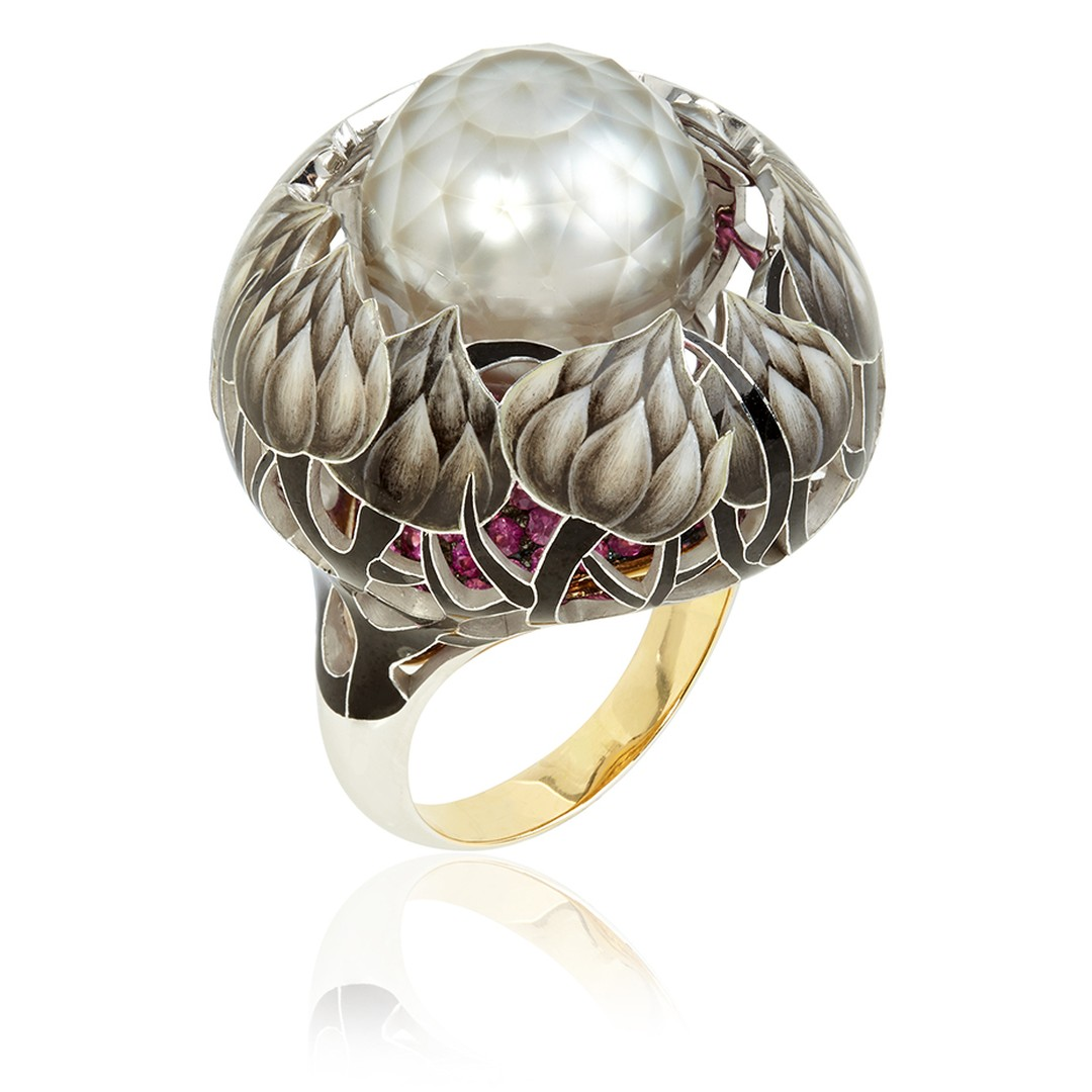 llgiz F collection for Annoushka combines extraordinary faceted pearls and exquisite enamel in designs inspired by nature and depicted in intricate detail. The Burdock ring features enamel painted flowers which climb up a ruby-covered base towards the cen