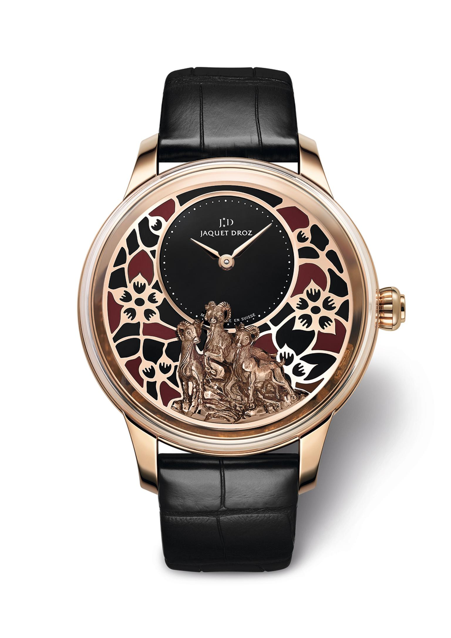 The red gold 41 mm Petite Heure Model by Jaquet Droz features the same plum blossom motif against a black onyx background. Both models, in red gold and white gold, are limited to 28 pieces.