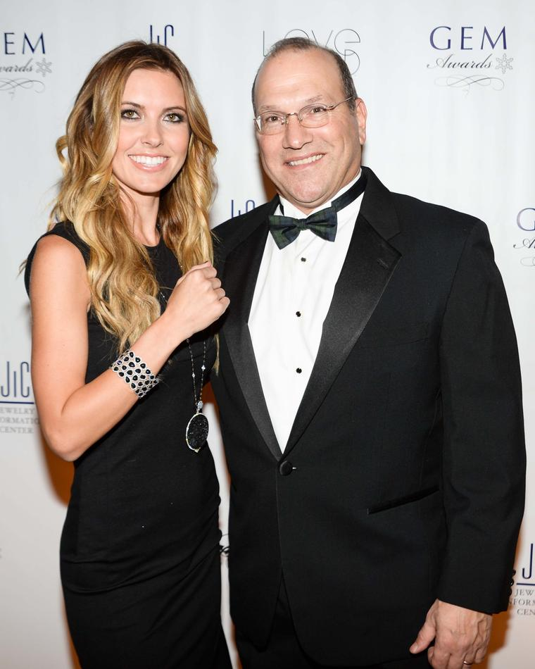 US TV presenter Audrina Partridge with David J. Bonaparte, CEO of Jewelers of America, at the 2014 GEM Awards in New York.