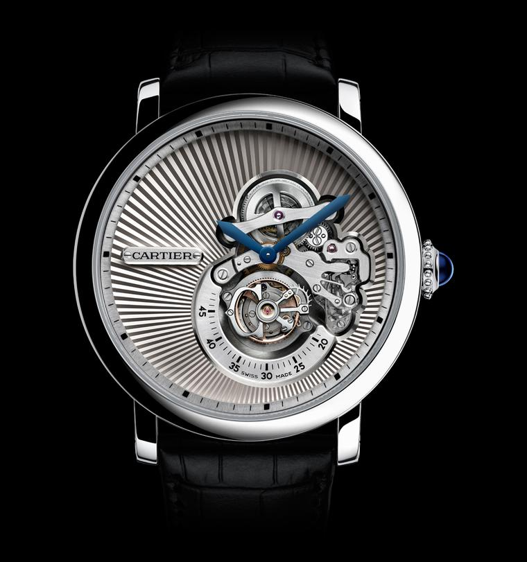 The Rotonde de Cartier Reversed Tourbillon Watch is an artistic, unconventional and extremely beautiful watch crafted in white gold. The sunray guilloché pleats of white gold that draw the eye in to the action are almost like the pleats on a stiffly starc