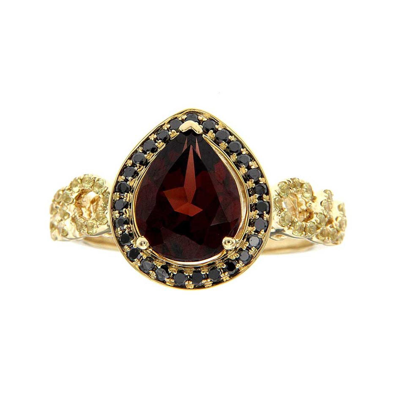 H.AZEEM King Bird of Paradise ring in yellow gold, set with a central pyrope garnet, black diamonds and yellow sapphires.