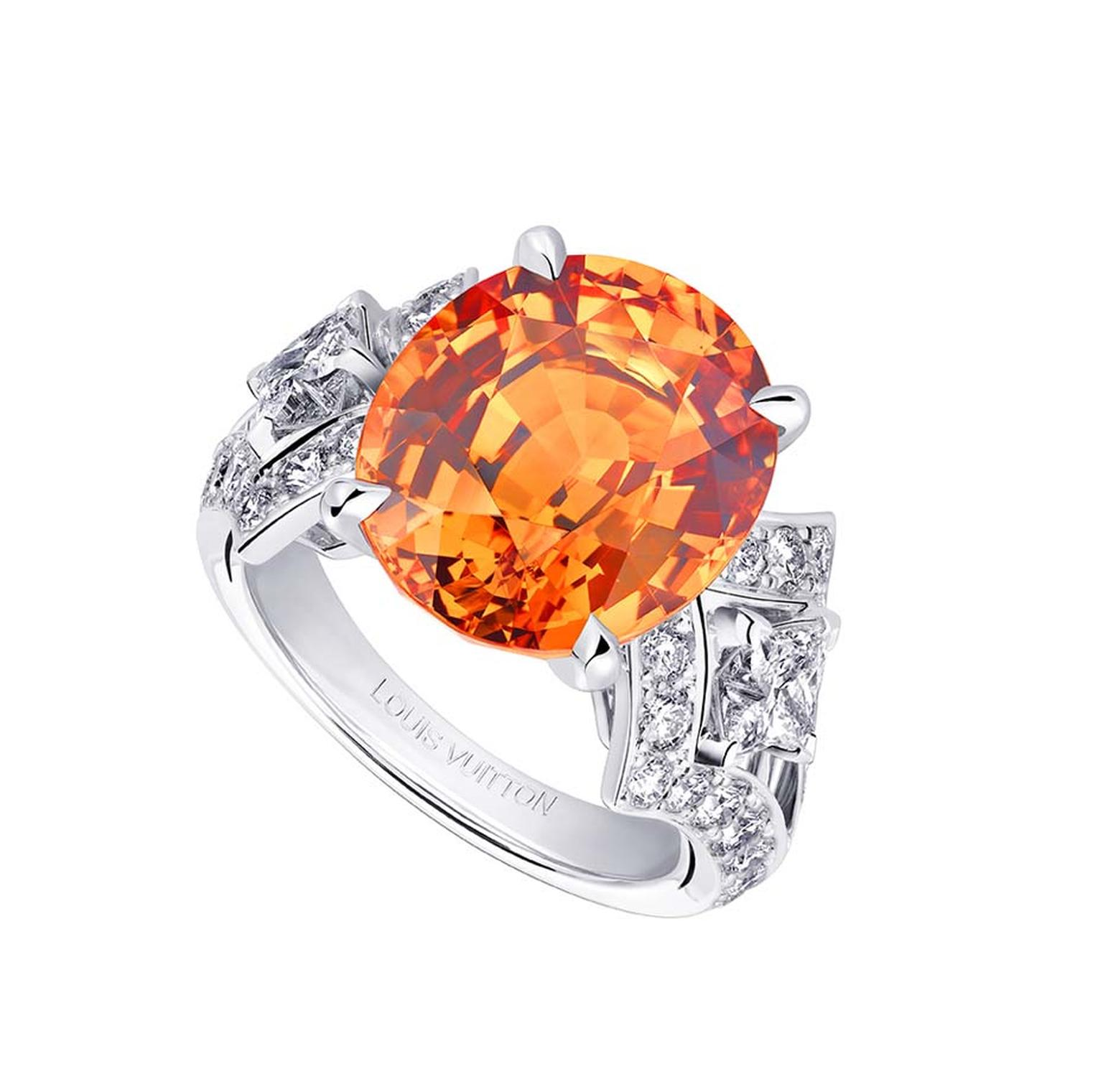 Louis Vuitton ring from the Acte V high jewellery collection, set with a central mandarin garnet surrounded by diamonds.