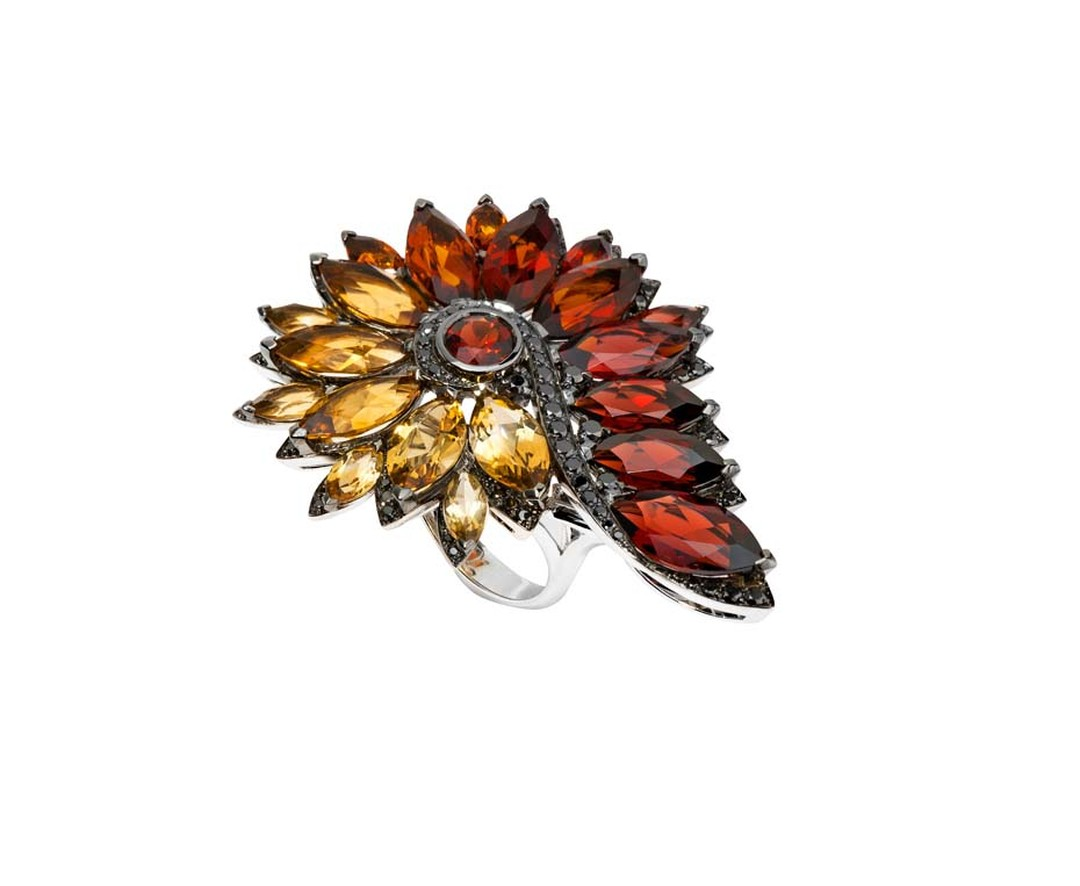 Stephen Webster Albion Rose Magnipheasant ring set with pyrope garnets and citrines.