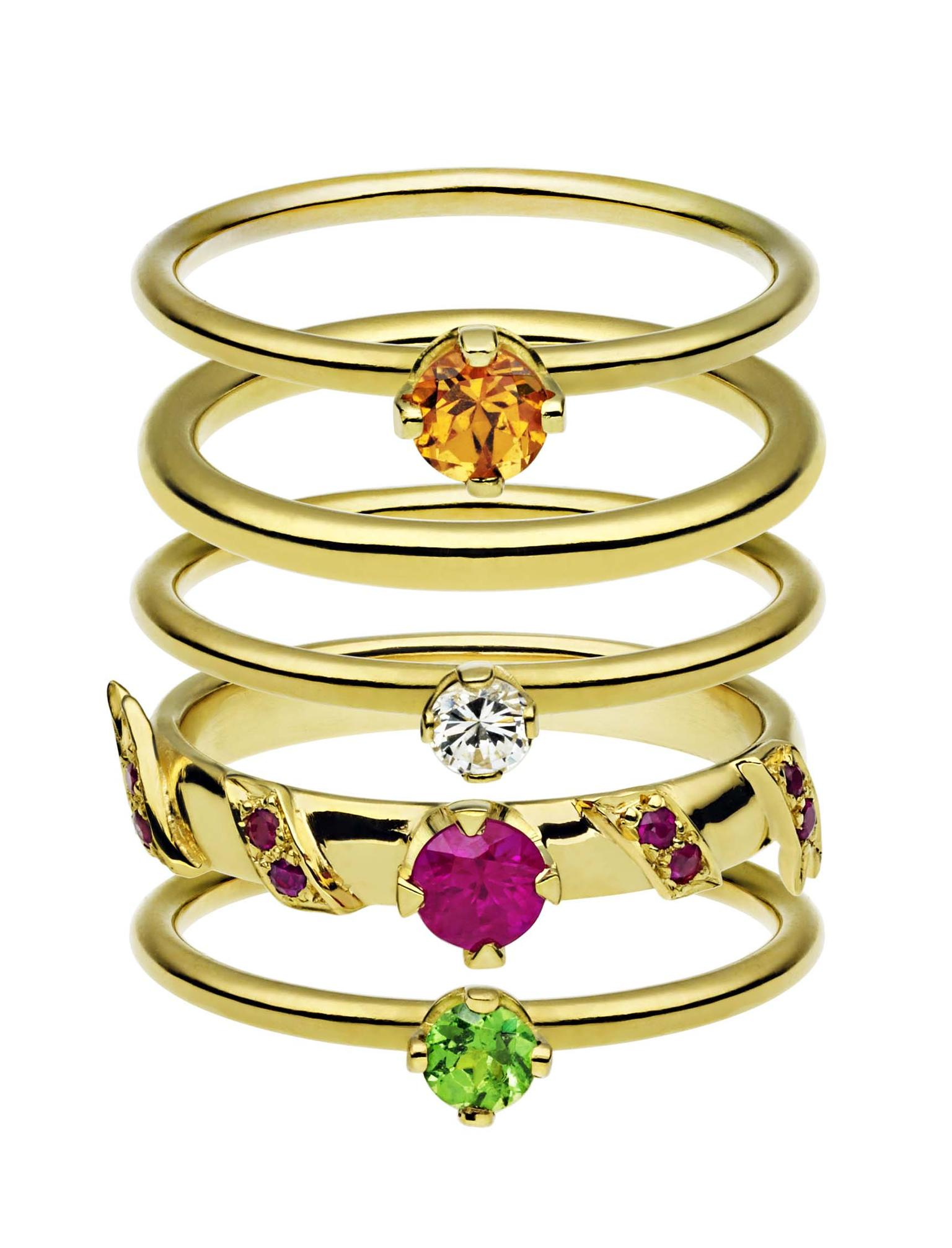 Ana de Costa stacking rings in yellow gold set with, top to bottom, a mandarin garnet, diamond, rubies and a tsavorite. From the Alchemy collection.
