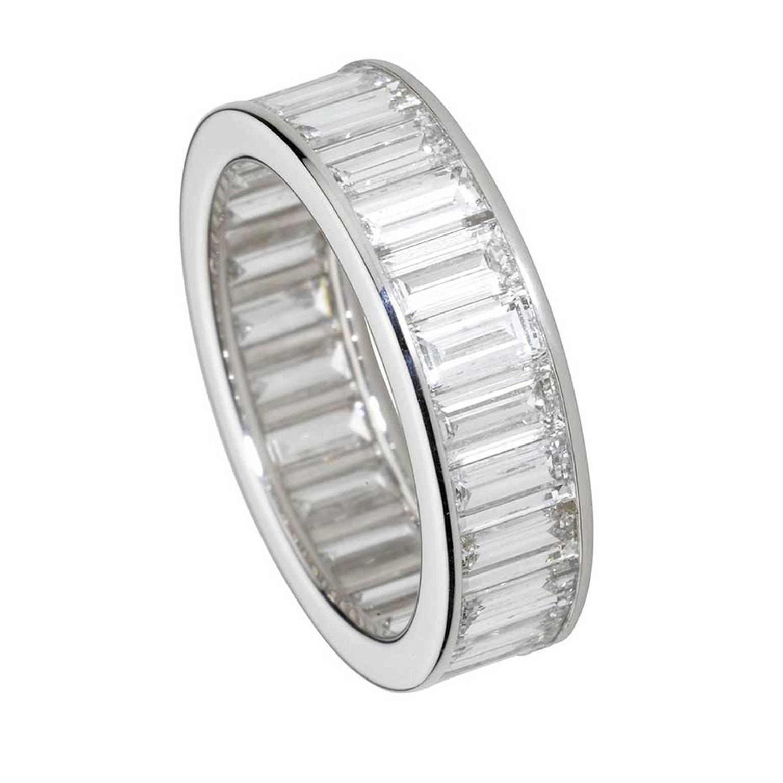Cartier eternity ring in platinum, set with baguette-cut diamonds.