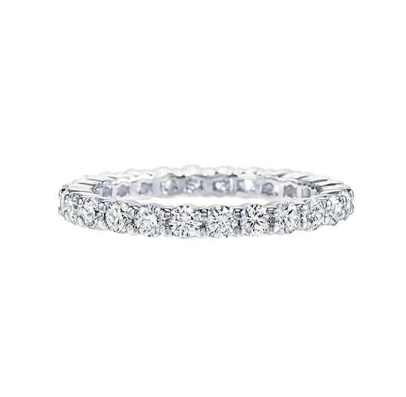 Harry Winston eternity ring in platinum, prong-set with 26 round brilliant diamonds.