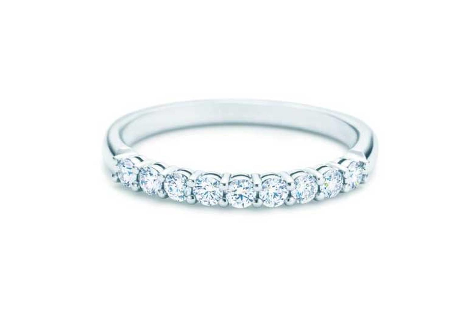 Tiffany & Co. half circle eternity ring in platinum, set with round brilliant diamonds.