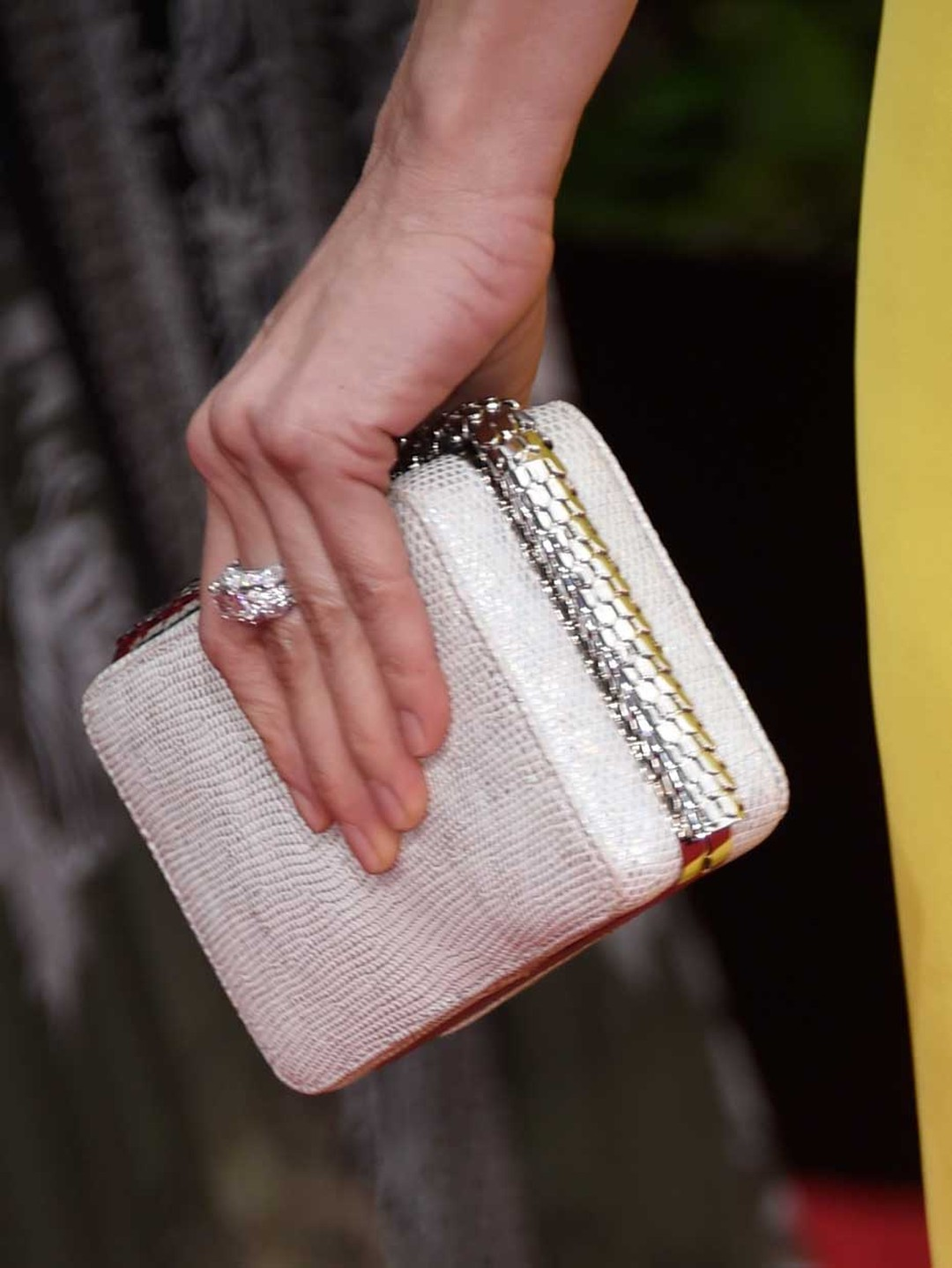 A close-up of the Bulgari Serpenti cocktail clutch and ring worn by Naomi Watts at the 2015 Golden Globes.