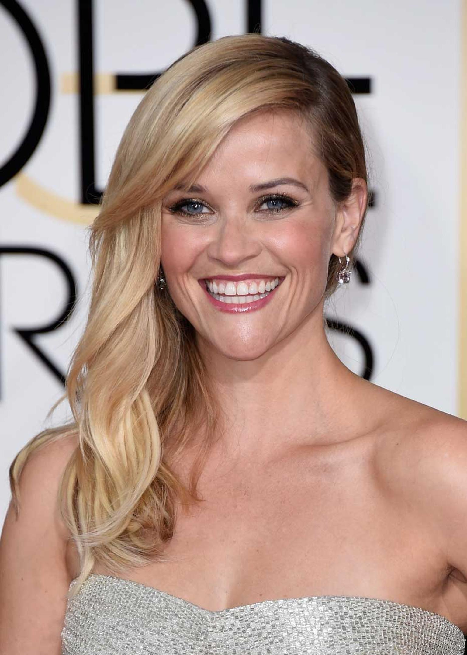 Reese Witherspoon in platinum and diamond earrings and ring from Tiffany & Co. at the 2015 Golden Globes.