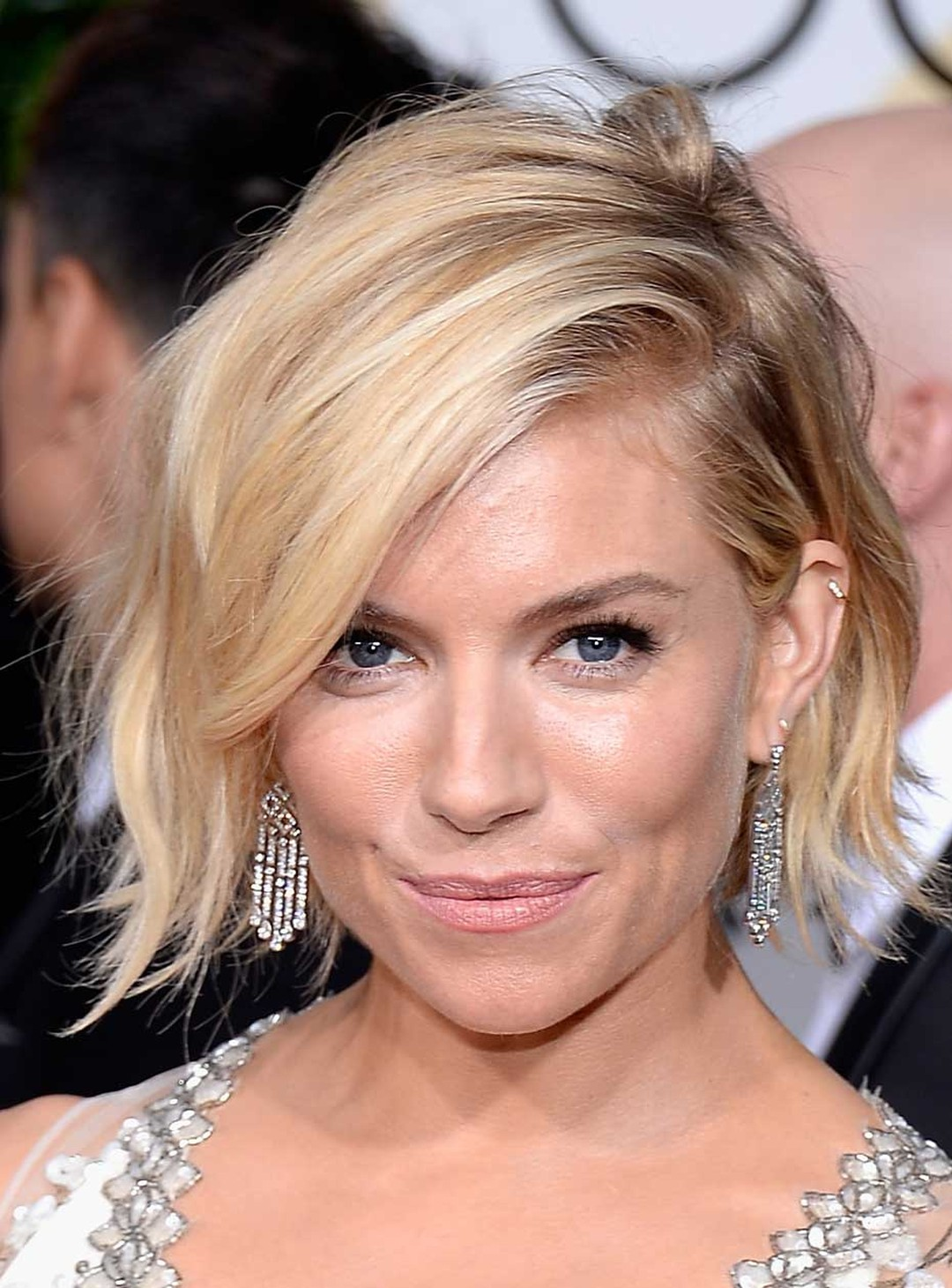 British actress Sienna Miller showcased these Platinum and diamond drop earrings from Tiffany and Co. at the 2015 Golden Globe Awards. (Getty Images)