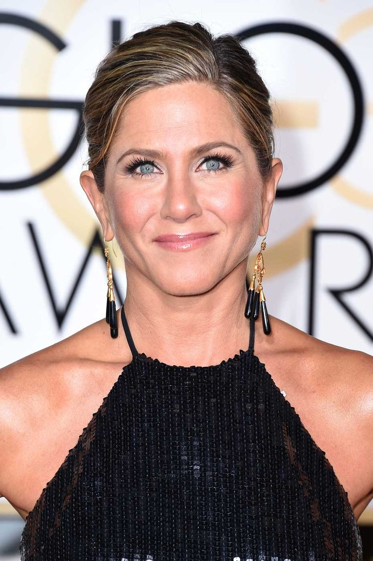 Best actress nominee Jennifer Aniston wore a pair of antique gold and black onyx earrings by Neil Lane.