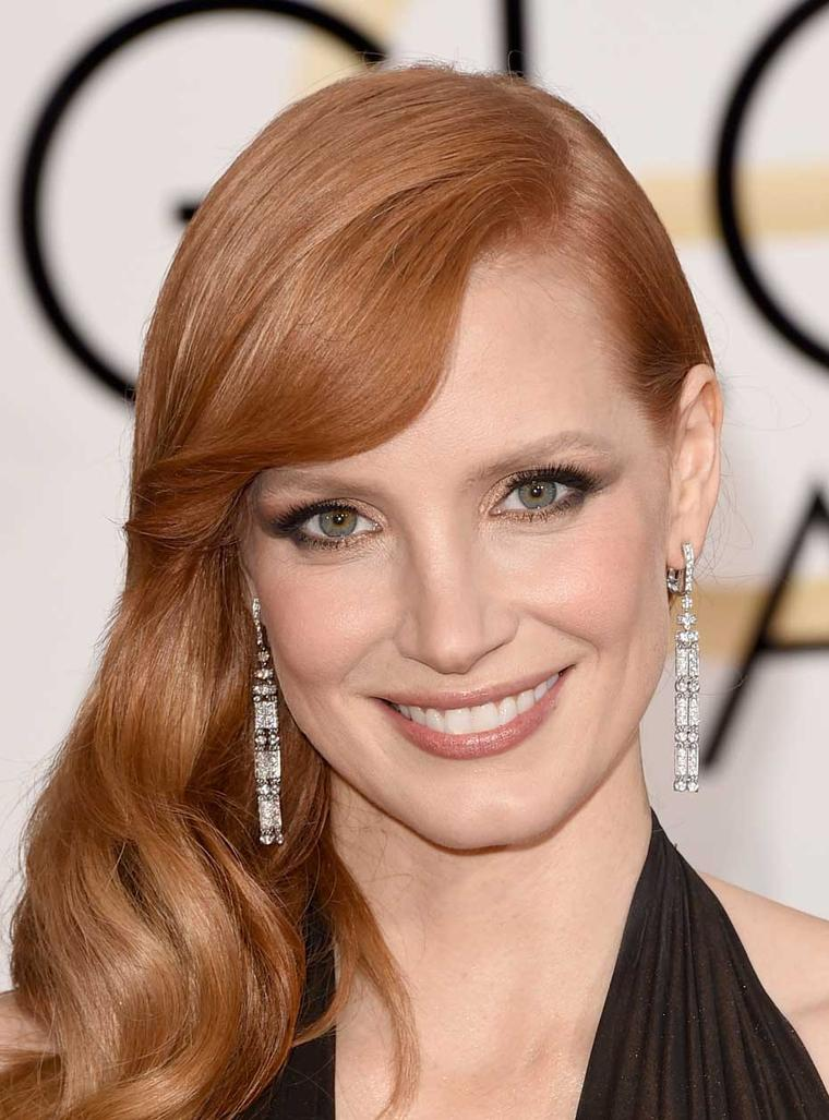 The Piaget Limelight Couture Précieuse Earrings in white gold with diamonds worn at the 2015 Golden Globes by American actress Jessica Chastain.