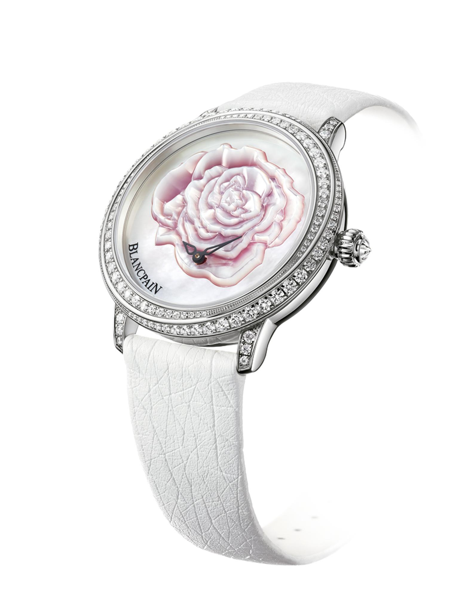 Blancpain watches has created a very special ladies' watch for Valentine's Day featuring a sculpted, pink mother-of-pearl rose in the centre of the dial surrounded by 121 diamonds on the bezel and lugs. Presented in a 36.8mm white gold case, the watch is