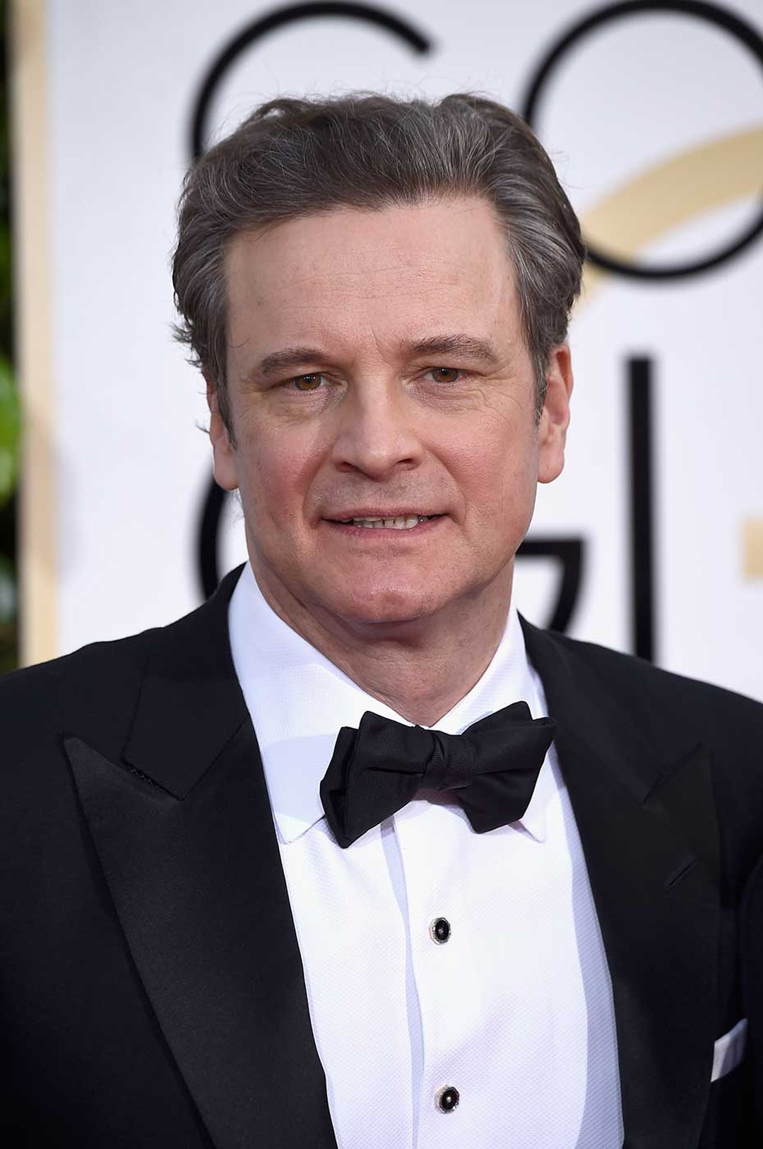 British actor Colin Firth wore an elegant Chopard L.U.C XPS watch in white gold with a black dial to the Golden Globe Awards 2015. (Getty Images)