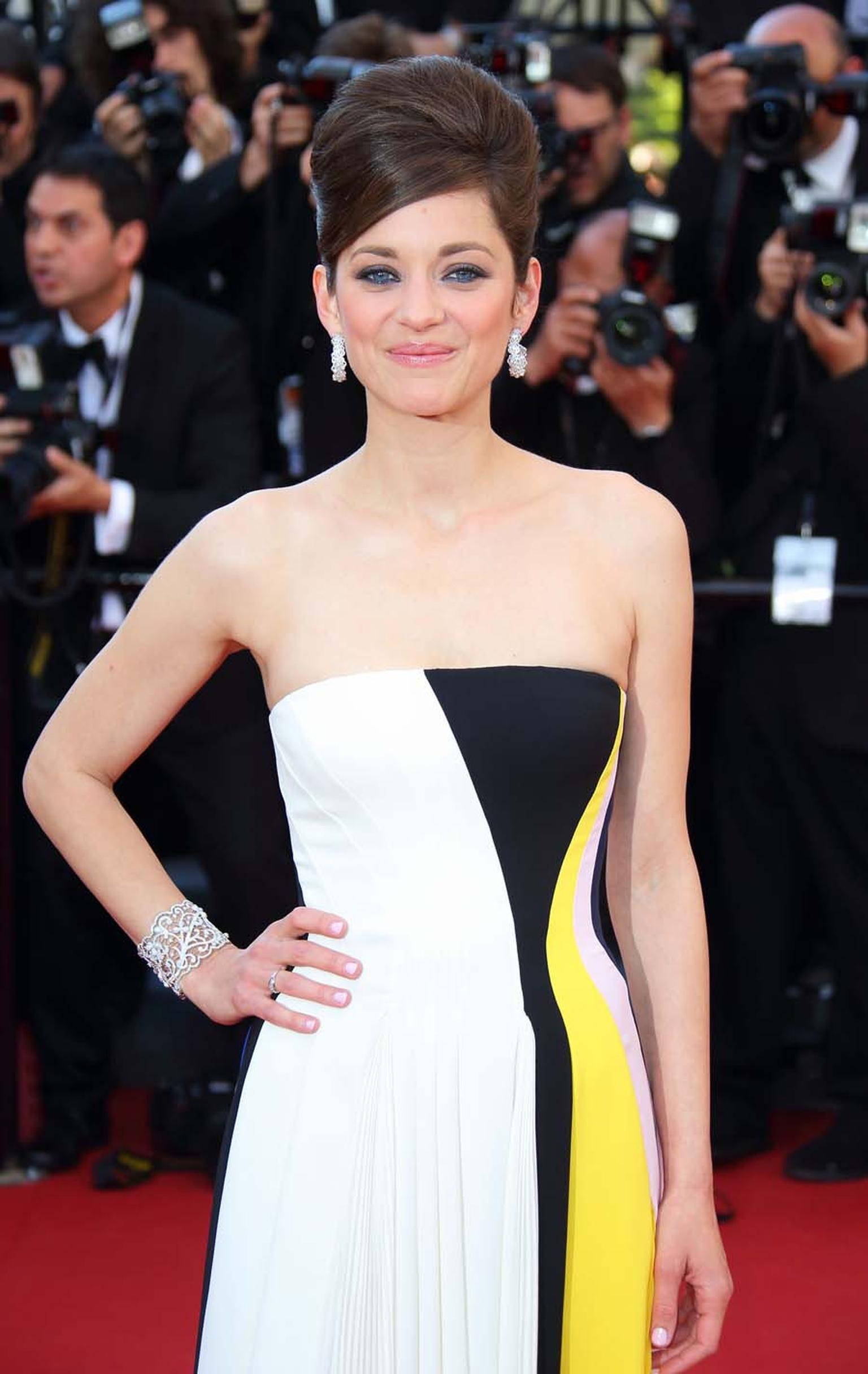Marion Cotillard was the first to wear Chopard's Green Carpet Collection jewelry, made from Fairmined gold, on the red carpet at the Cannes Film Festival 2013.