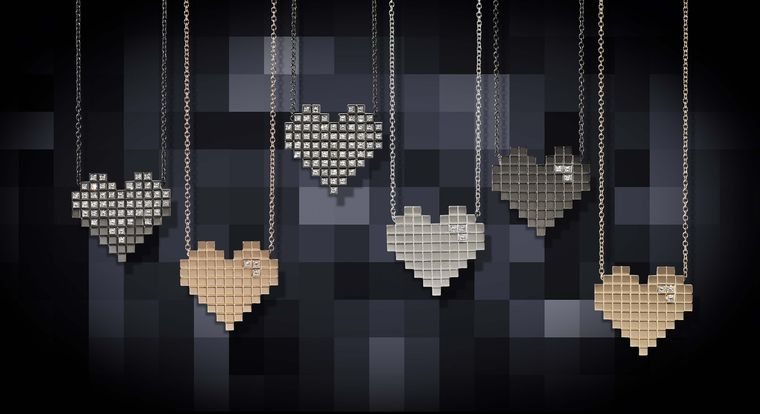 Francesca Grima gold necklaces from the Pixel Hearts collection.