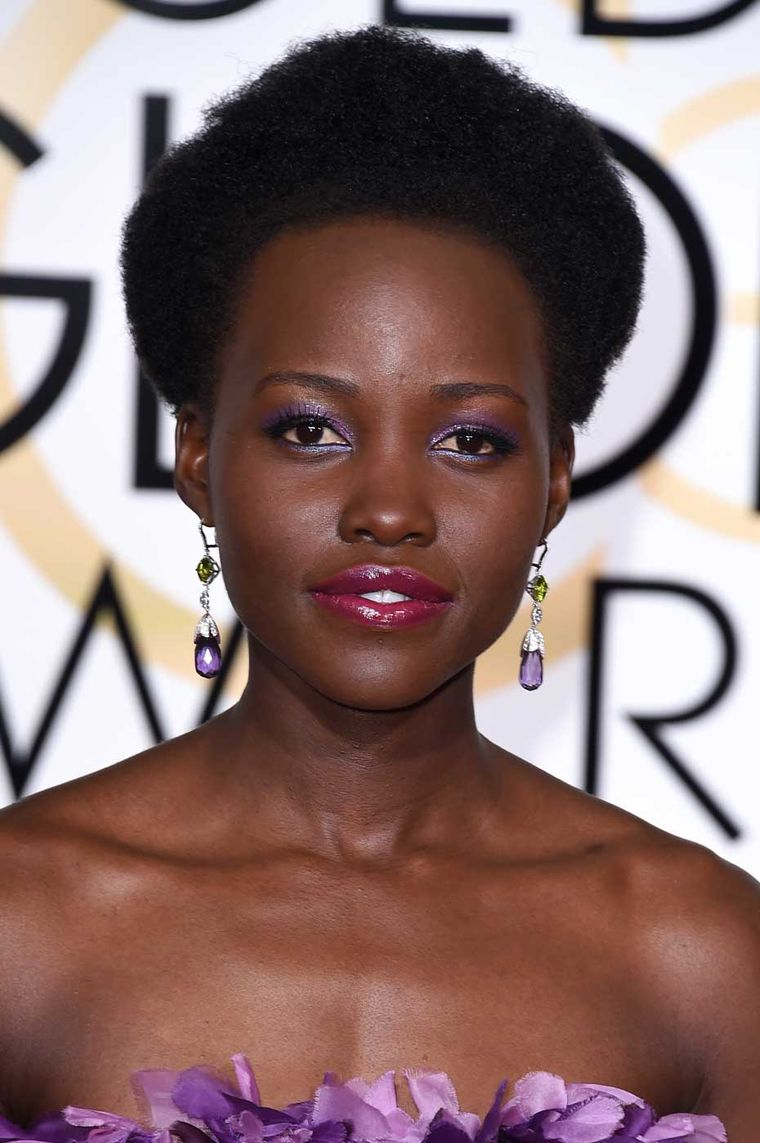 At the 2015 Golden Globes Lupita Nyong'o wore a Giambattista Valli couture gown and amethyst Chopard earrings.