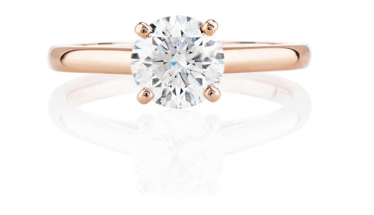 Simple and elegant, this De Beers rose gold engagement ring is flawless and illustrates perfectly how rose gold intensifies the bright white sparkle of a diamond.
