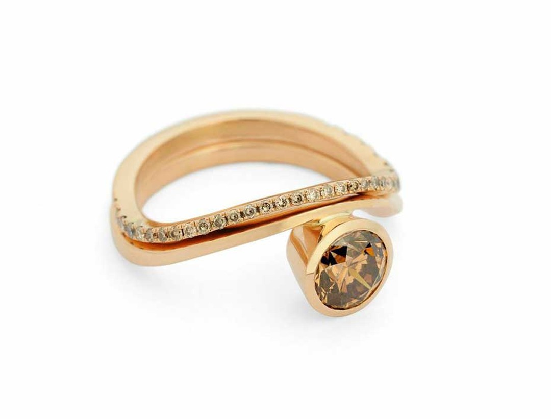 Rose gold engagement ring by McCaul Goldsmiths with a central cognac diamond and matching cognac diamond wedding band.