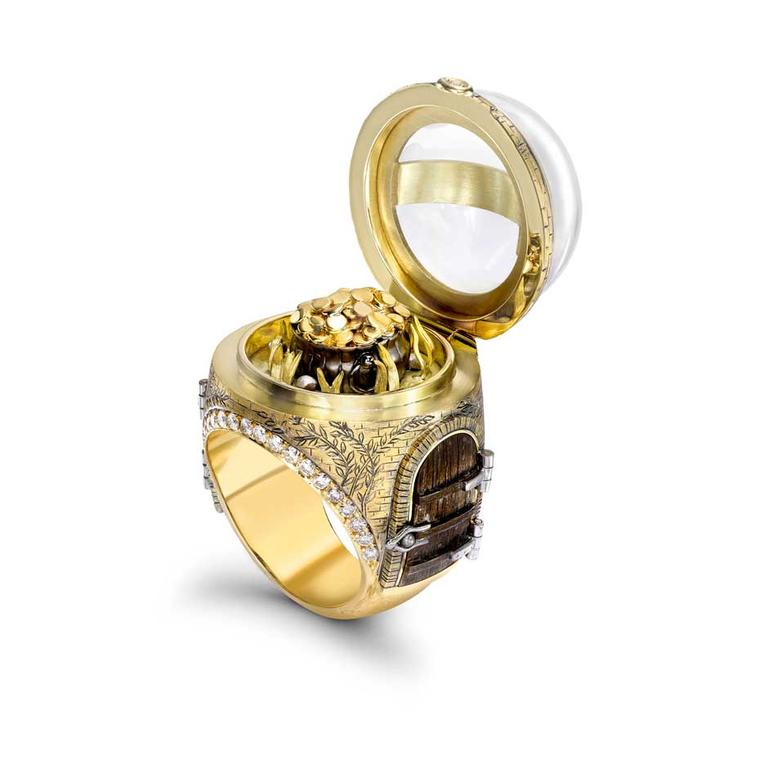 Theo Fennell's Over the Rainbow ring in yellow gold with pavé diamonds and rock crystal opens to reveal your very own pot of gold.