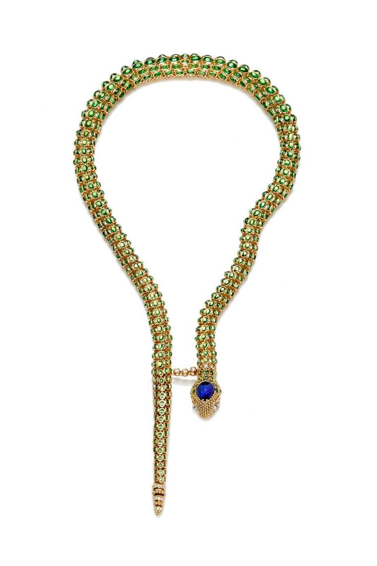 Temple St. Clair Secret Garden Serpent necklace in yellow gold with tanzanite, Royal Blue moonstone and diamonds. The skeleton of mobile gold vertebrae is set with more than 1,000 gemstones.